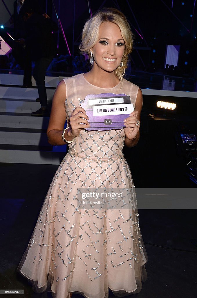 Singer <a gi-track='captionPersonalityLinkClicked' href=/galleries/search?phrase=Carrie+Underwood&family=editorial&specificpeople=204483 ng-click='$event.stopPropagation()'>Carrie Underwood</a> attends the 2013 CMT Music Awards at the Bridgestone Arena on June 5, 2013 in Nashville, Tennessee.