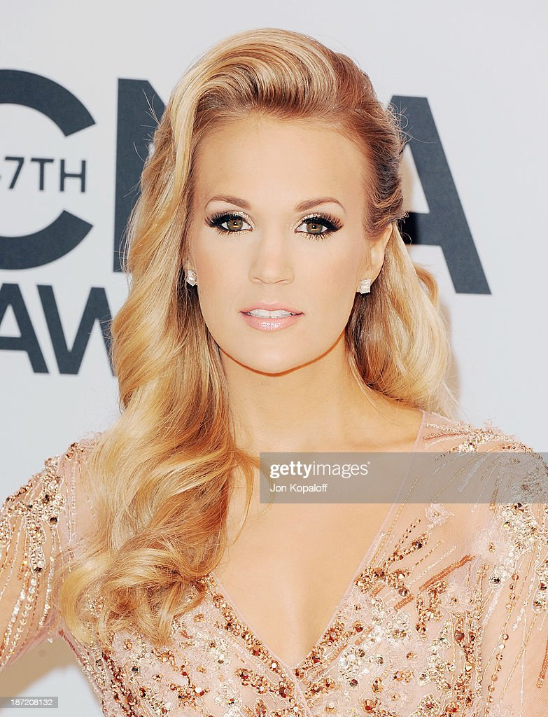Singer <a gi-track='captionPersonalityLinkClicked' href=/galleries/search?phrase=Carrie+Underwood&family=editorial&specificpeople=204483 ng-click='$event.stopPropagation()'>Carrie Underwood</a> attends the 47th annual CMA Awards at the Bridgestone Arena on November 6, 2013 in Nashville, Tennessee.