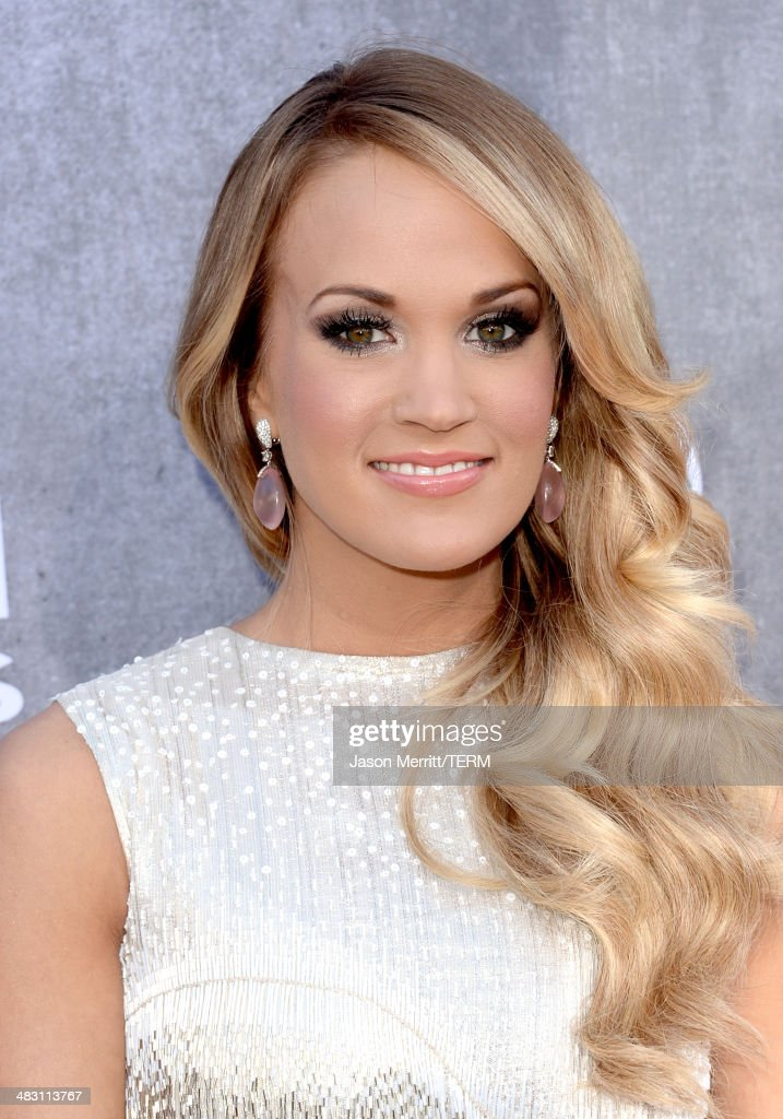 Singer <a gi-track='captionPersonalityLinkClicked' href=/galleries/search?phrase=Carrie+Underwood&family=editorial&specificpeople=204483 ng-click='$event.stopPropagation()'>Carrie Underwood</a> attends the 49th Annual Academy Of Country Music Awards at the MGM Grand Garden Arena on April 6, 2014 in Las Vegas, Nevada.