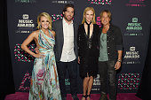 Singer Carrie Underwood NHL player Mike Fisher actress Nicole Kidman and musician Keith Urban attend the 2016 CMT Music awards at the Bridgestone...