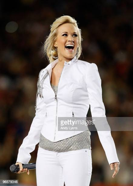 Singer Carrie Underwood performs during the pregame show prior to Super Bowl XLIV between the Indianapolis Colts and the New Orleans Saints on...