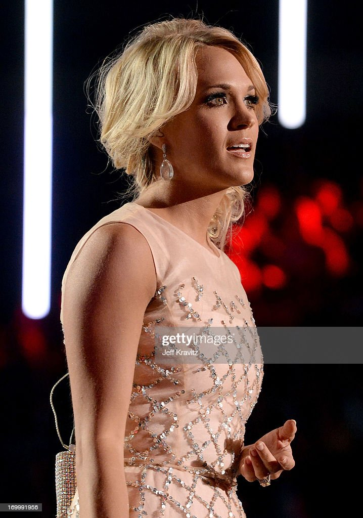 Singer <a gi-track='captionPersonalityLinkClicked' href=/galleries/search?phrase=Carrie+Underwood&family=editorial&specificpeople=204483 ng-click='$event.stopPropagation()'>Carrie Underwood</a> performs onstage at the 2013 CMT Music Awards at the Bridgestone Arena on June 5, 2013 in Nashville, Tennessee.