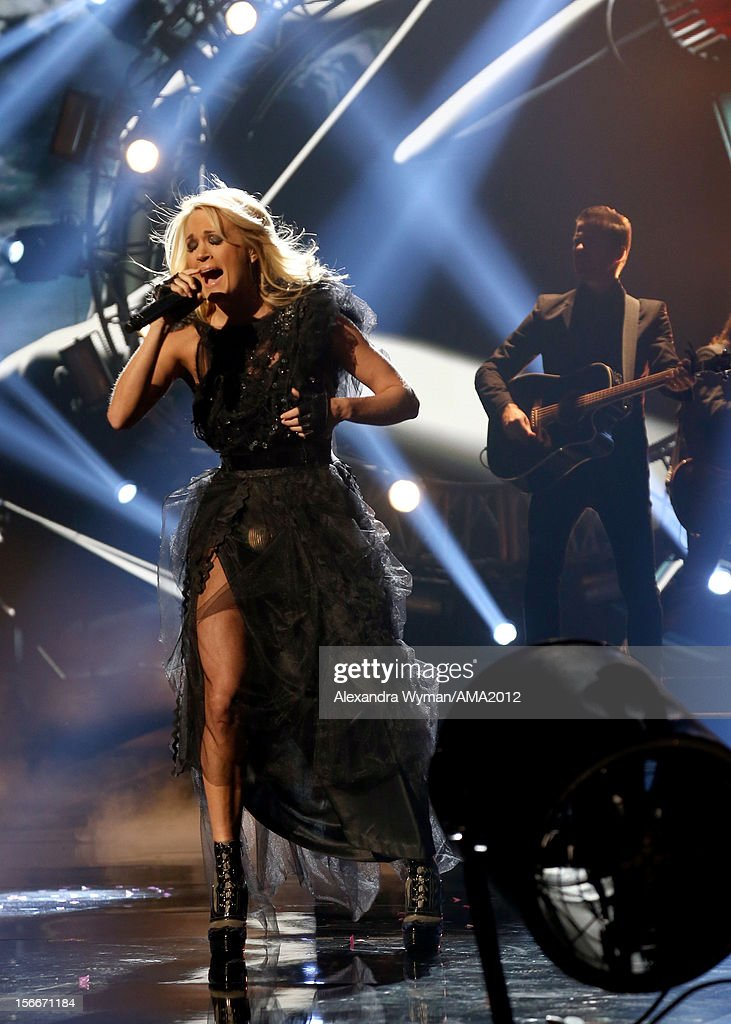 Singer <a gi-track='captionPersonalityLinkClicked' href=/galleries/search?phrase=Carrie+Underwood&family=editorial&specificpeople=204483 ng-click='$event.stopPropagation()'>Carrie Underwood</a> performs onstage at the 40th American Music Awards held at Nokia Theatre L.A. Live on November 18, 2012 in Los Angeles, California.