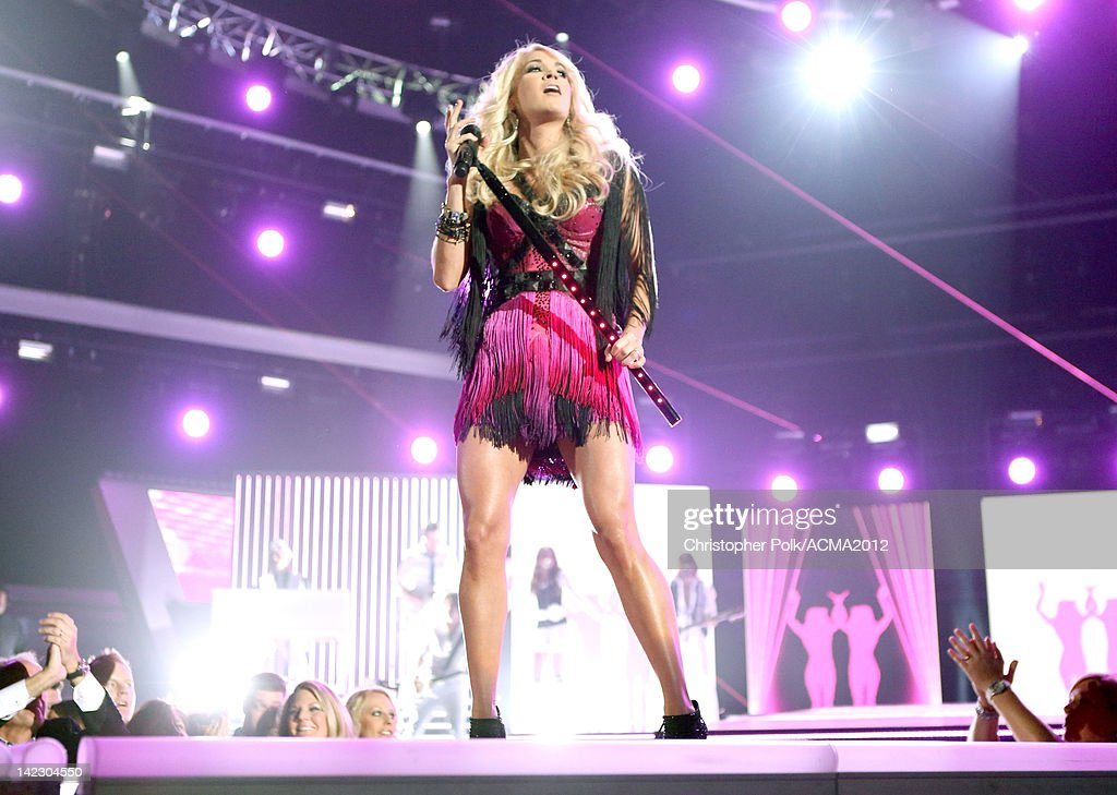 Singer <a gi-track='captionPersonalityLinkClicked' href=/galleries/search?phrase=Carrie+Underwood&family=editorial&specificpeople=204483 ng-click='$event.stopPropagation()'>Carrie Underwood</a> performs onstage at the 47th Annual Academy Of Country Music Awards held at the MGM Grand Garden Arena on April 1, 2012 in Las Vegas, Nevada.