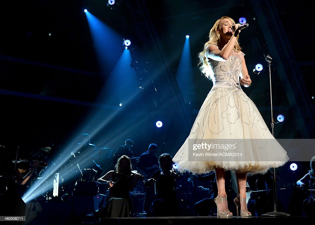 Singer <a gi-track='captionPersonalityLinkClicked' href=/galleries/search?phrase=Carrie+Underwood&family=editorial&specificpeople=204483 ng-click='$event.stopPropagation()'>Carrie Underwood</a> performs onstage during ACM Presents: An All-Star Salute To The Troops at the MGM Grand Garden Arena on April 7, 2014 in Las Vegas, Nevada.