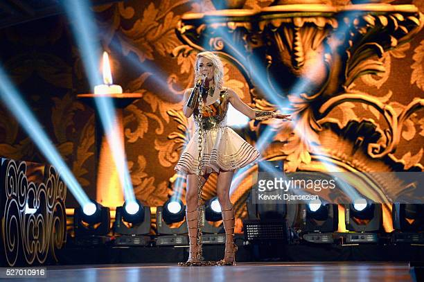 Singer Carrie Underwood performs onstage during the 2016 American Country Countdown Awards at The Forum on May 1 2016 in Inglewood California