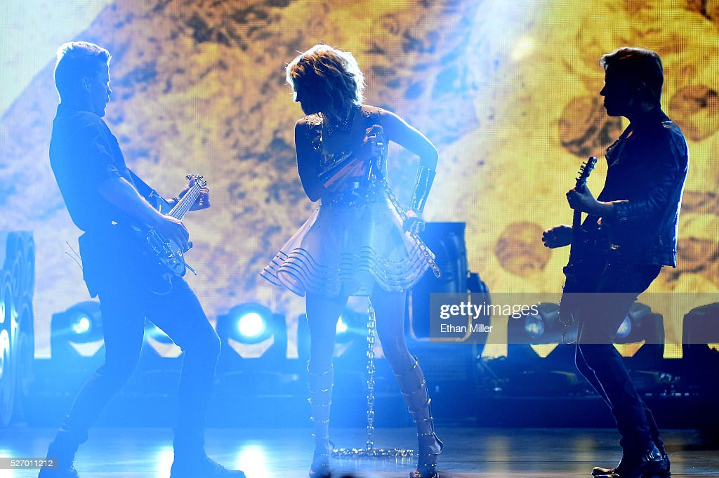 Singer <a gi-track='captionPersonalityLinkClicked' href=/galleries/search?phrase=Carrie+Underwood&family=editorial&specificpeople=204483 ng-click='$event.stopPropagation()'>Carrie Underwood</a> (C) performs onstage during the 2016 American Country Countdown Awards at The Forum on May 1, 2016 in Inglewood, California.