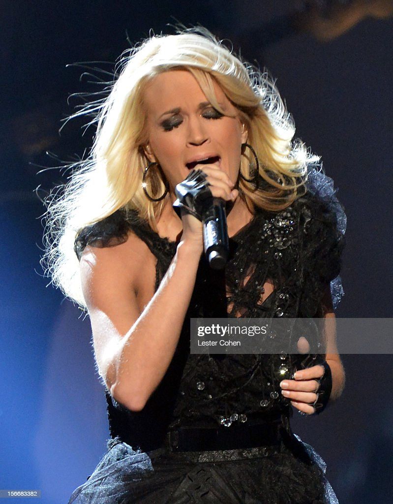 Singer <a gi-track='captionPersonalityLinkClicked' href=/galleries/search?phrase=Carrie+Underwood&family=editorial&specificpeople=204483 ng-click='$event.stopPropagation()'>Carrie Underwood</a> performs onstage during the 40th Anniversary American Music Awards held at Nokia Theatre L.A. Live on November 18, 2012 in Los Angeles, California.