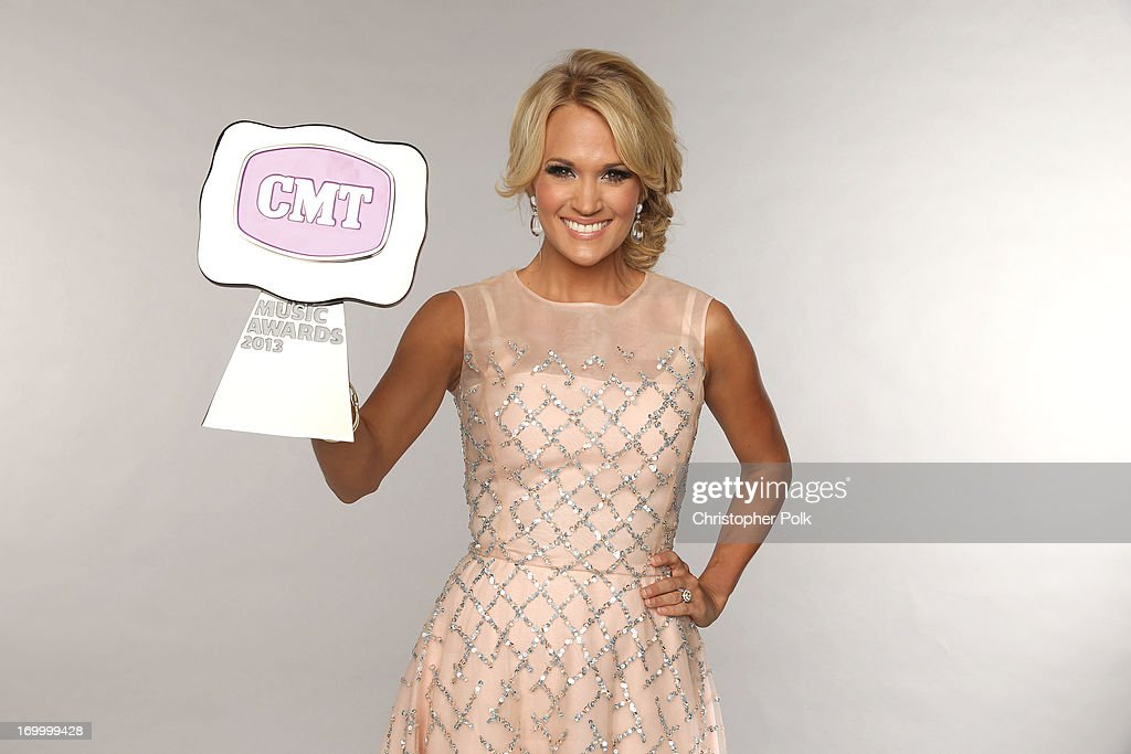 Singer Carrie Underwood poses at the Wonderwall portrait studio during the 2013 CMT Music Awards at Bridgestone Arena on June 5, 2013 in Nashville, Tennessee.