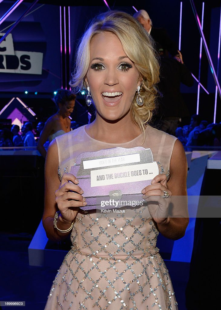 Singer Carrie Underwood poses backstage at the 2013 CMT Music awards at the Bridgestone Arena on June 5, 2013 in Nashville, Tennessee.