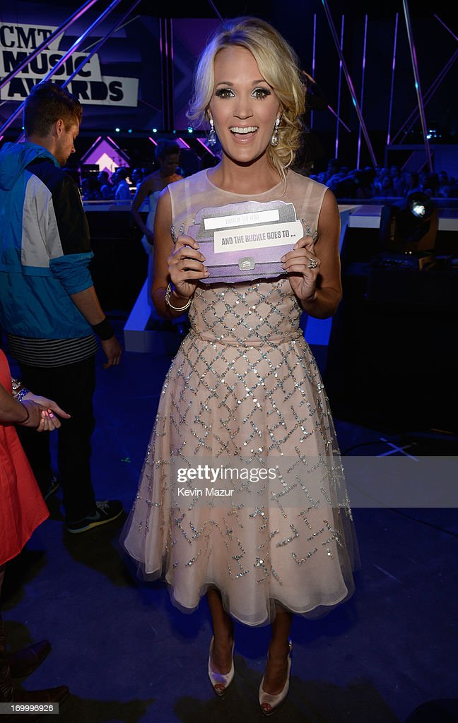 Singer <a gi-track='captionPersonalityLinkClicked' href=/galleries/search?phrase=Carrie+Underwood&family=editorial&specificpeople=204483 ng-click='$event.stopPropagation()'>Carrie Underwood</a> poses backstage at the 2013 CMT Music awards at the Bridgestone Arena on June 5, 2013 in Nashville, Tennessee.