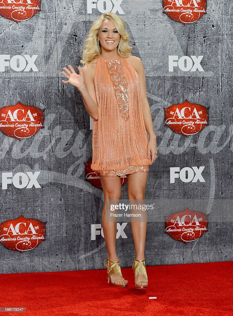 Singer Carrie Underwood poses in the press room after winning the awards for Female Artist of the Year and Single by a Vocal Collaboration during the 2012 American Country Awards at the Mandalay Bay Events Center on December 10, 2012 in Las Vegas, Nevada.