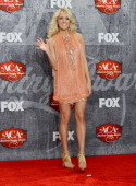 Singer Carrie Underwood poses in the press room after winning the awards for Female Artist of the Year and Single by a Vocal Collaboration during the...