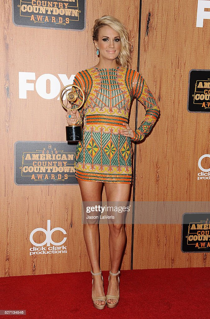 Singer <a gi-track='captionPersonalityLinkClicked' href=/galleries/search?phrase=Carrie+Underwood&family=editorial&specificpeople=204483 ng-click='$event.stopPropagation()'>Carrie Underwood</a> poses in the press room at the 2016 American Country Countdown Awards at The Forum on May 01, 2016 in Inglewood, California.