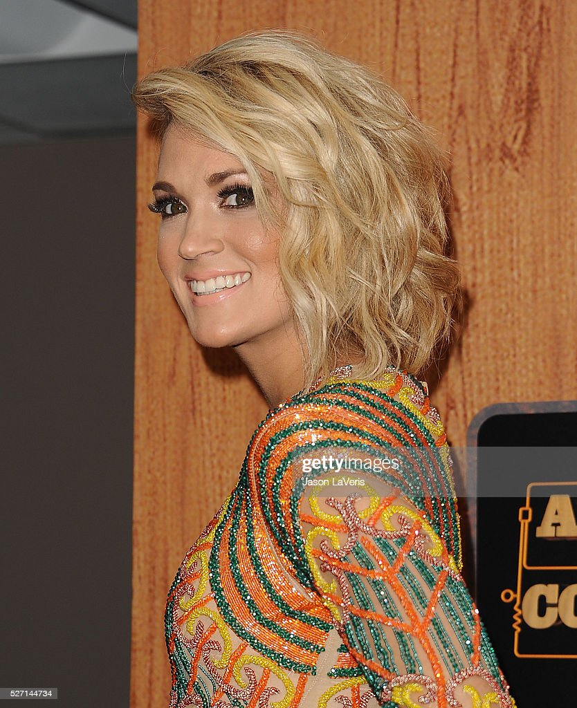 Singer Carrie Underwood poses in the press room at the 2016 American Country Countdown Awards at The Forum on May 01, 2016 in Inglewood, California.