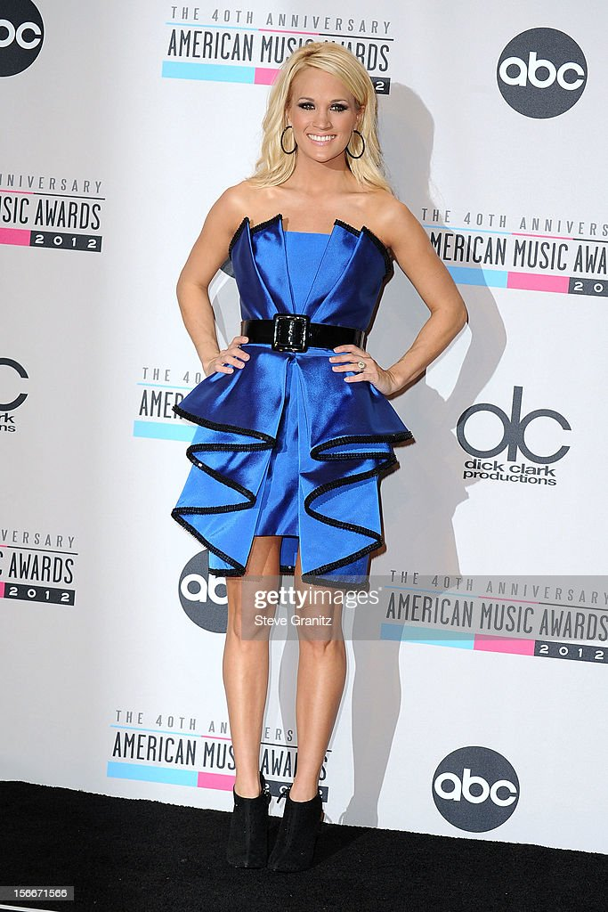Singer <a gi-track='captionPersonalityLinkClicked' href=/galleries/search?phrase=Carrie+Underwood&family=editorial&specificpeople=204483 ng-click='$event.stopPropagation()'>Carrie Underwood</a> poses in the press room at the 40th Anniversary American Music Awards held at Nokia Theatre L.A. Live on November 18, 2012 in Los Angeles, California.