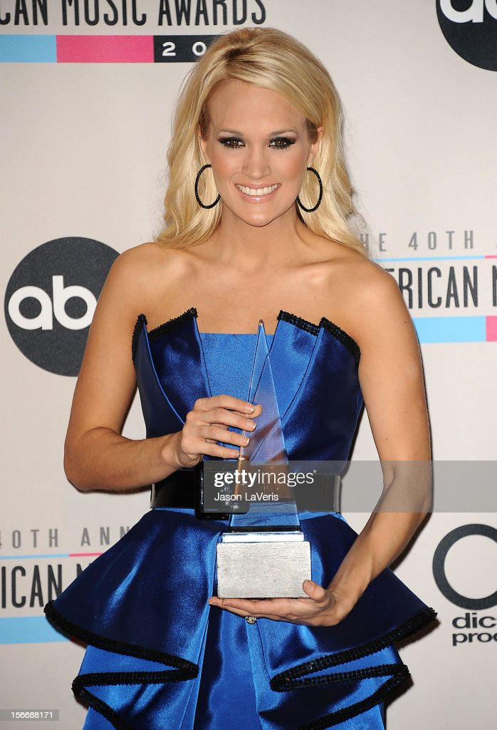 Singer <a gi-track='captionPersonalityLinkClicked' href=/galleries/search?phrase=Carrie+Underwood&family=editorial&specificpeople=204483 ng-click='$event.stopPropagation()'>Carrie Underwood</a> poses in the press room at the 40th American Music Awards at Nokia Theatre L.A. Live on November 18, 2012 in Los Angeles, California.