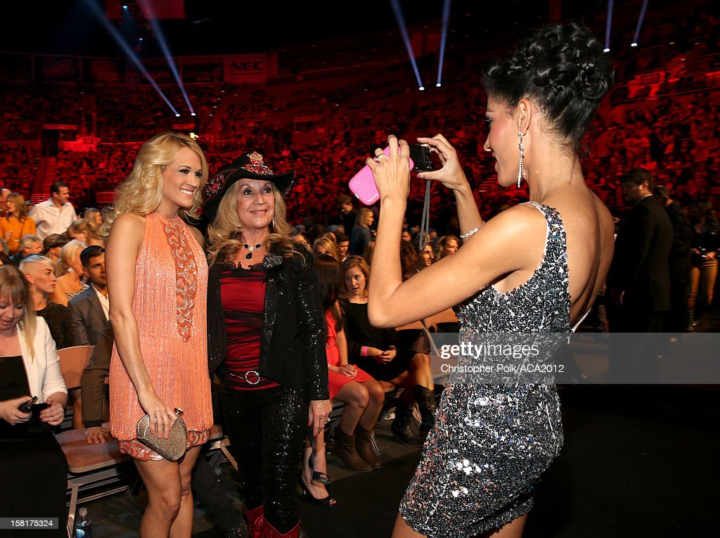 Singer Carrie Underwood (L) poses with a fan during the 2012 American Country Awards at the Mandalay Bay Events Center on December 10, 2012 in Las Vegas, Nevada.