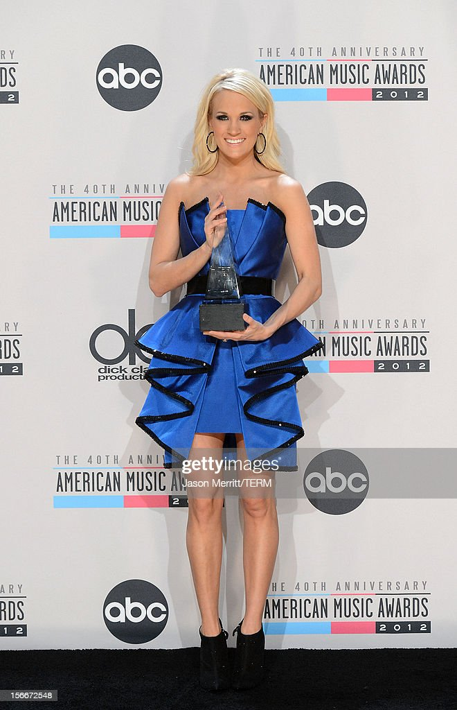 Singer <a gi-track='captionPersonalityLinkClicked' href=/galleries/search?phrase=Carrie+Underwood&family=editorial&specificpeople=204483 ng-click='$event.stopPropagation()'>Carrie Underwood</a> poses with the Favorite Country Music Album for 'Blown Away' in the press room at the 40th American Music Awards held at Nokia Theatre L.A. Live on November 18, 2012 in Los Angeles, California.