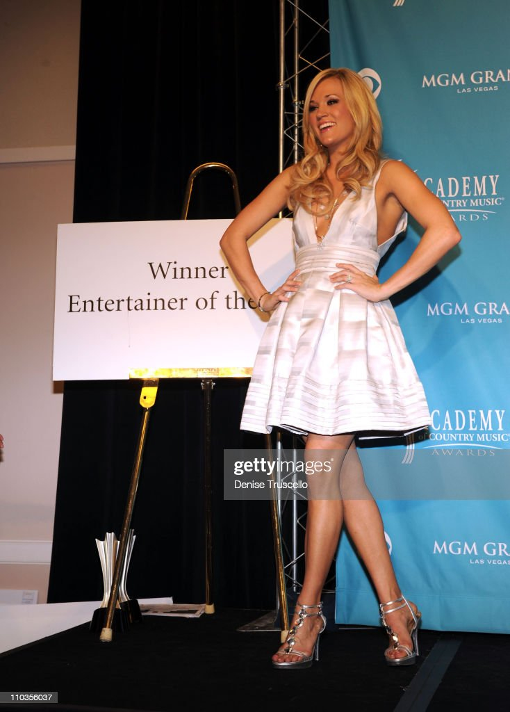 Singer Carrie Underwood, winner of Entertainer of the Year Award and the Triple Crown Award poses in the press room during the 45th Annual Academy of Country Music Awards at the MGM Grand Garden Arena on April 18, 2010 in Las Vegas, Nevada.
