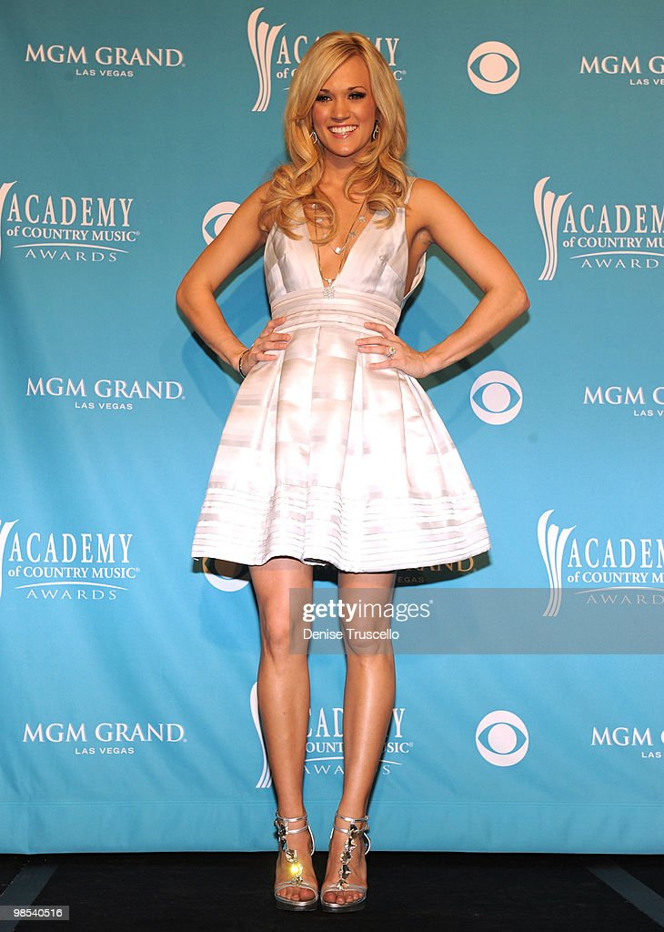 Singer Carrie Underwood, winner of Entertainer of the Year Award and the Triple Crown Award, poses in the press room during the 45th Annual Academy of Country Music Awards at the MGM Grand Garden Arena on April 18, 2010 in Las Vegas, Nevada.