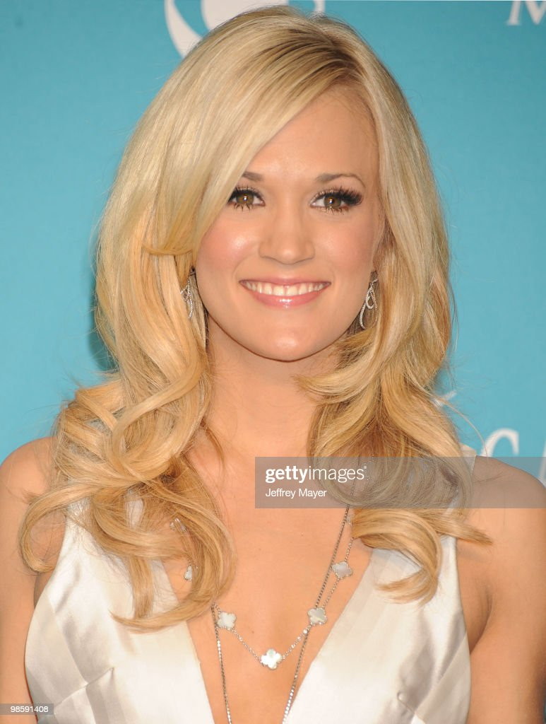 Singer Carrie Underwood, winner of Entertainer of the Year Award and the Triple Crown Award poses in the press room during the 45th Annual Academy of Country Music Awards at MGM Grand Garden Arena on April 18, 2010 in Las Vegas, Nevada.