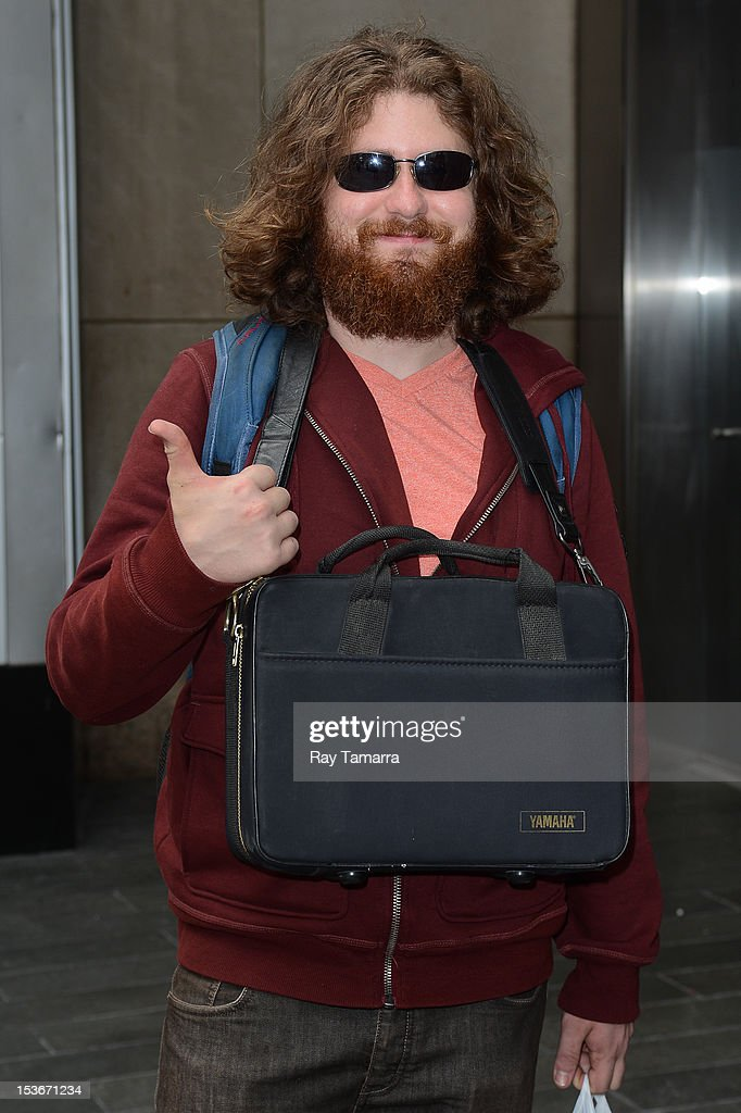 Singer <a gi-track='captionPersonalityLinkClicked' href=/galleries/search?phrase=Casey+Abrams&family=editorial&specificpeople=7534720 ng-click='$event.stopPropagation()'>Casey Abrams</a> enters the 'Big Morning Buzz' taping at the VH1 Studios on October 7, 2012 in New York City.