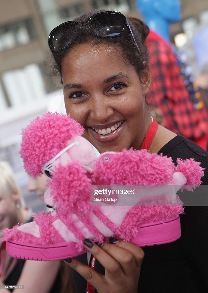 Singer Cassandra Steen holds up a shoe from the adidas Originals by Jeremy Scott collection at the adidas Originals Spring/Summer 13 collection at the Bread and Butter 2012 fashion trade fair on July 4, 2012 in Berlin, Germany.