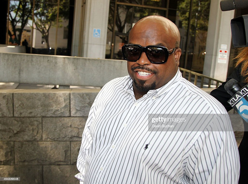 Singer CeeLo Green, whose real name is Thomas DeCarlo Callaway, attends a hearing at the Los Angeles Superior Court House on August 29, 2014 in Los Angeles, California. Green pleaded no contest to a felony charge of furnishing ecstasy and was sentenced to three years of probation. The charge stems from a 2012 incident where he was accused of slipping ecstasy into a woman's drink.