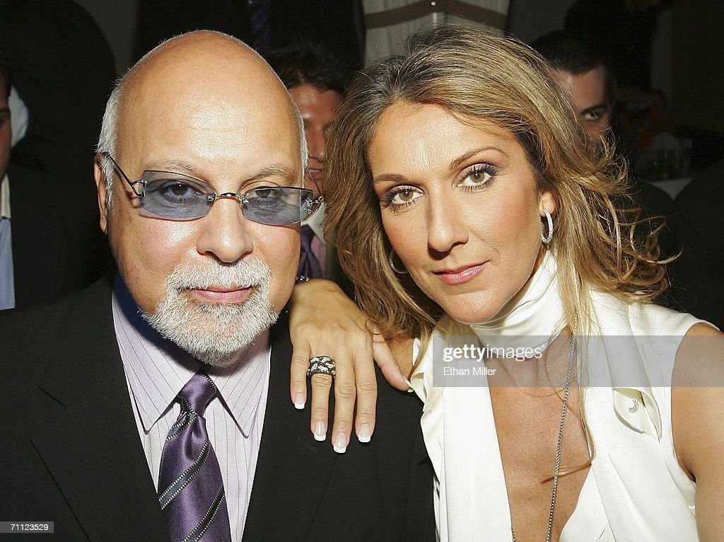 Singer Celine Dion (R) and her husband and manager Rene Angelil pose before a fashion show by jewelry designer Chris Aire at the Pure Nightclub at Caesars Palace June 4, 2006 in Las Vegas, Nevada.