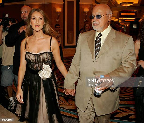 Singer Celine Dion and her husband and manager Rene Angelil walk from a news conference to a ceremony marking the opening of the 26story 949room...