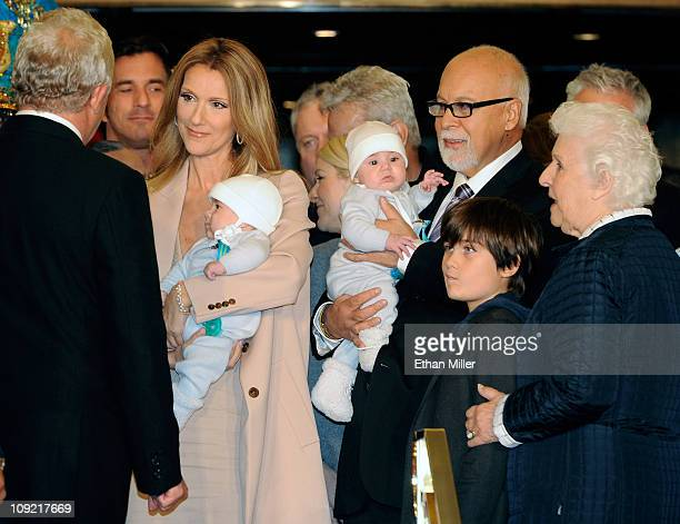 Singer Celine Dion holding her son Nelson Angelil her husband and manager Rene Angelil holding their son Eddy Angelil their son ReneCharles Angelil...