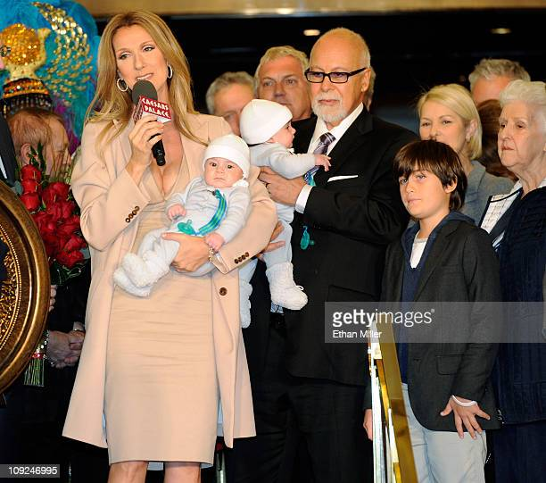 Singer Celine Dion holding her son Nelson Angelil her husband and manager Rene Angelil holding their son Eddy Angelil and their son ReneCharles...