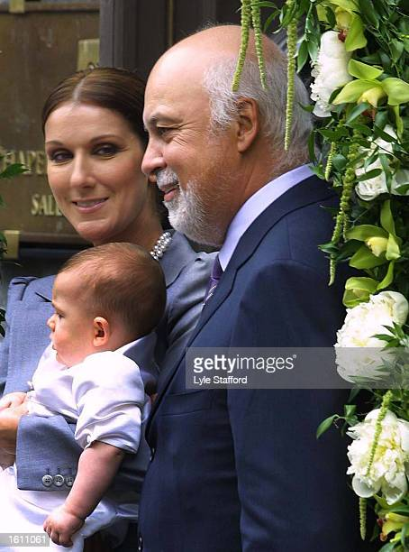 Singer Celine Dion holds her 6monthold baby ReneCharles as she and her husband Rene Angelil pose for fans and photographers July 25 2001 at the...
