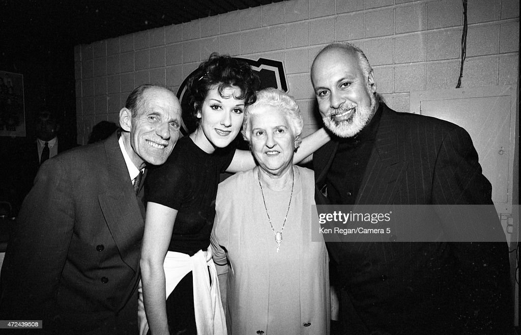 Singer Celine Dion is photographed backstage with husband Rene Angelil and parent in 1994 in Montreal, Quebec.
