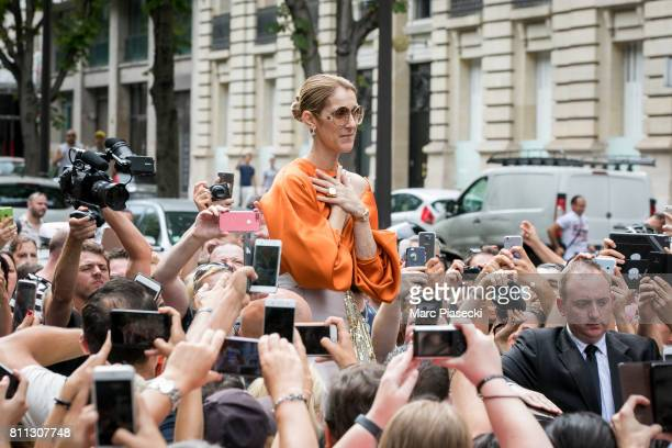 Singer Celine Dion is surrounded by french fans as she leaves the 'Royal Monceau' hotel on Avenue Hoche on July 9 2017 in Paris France