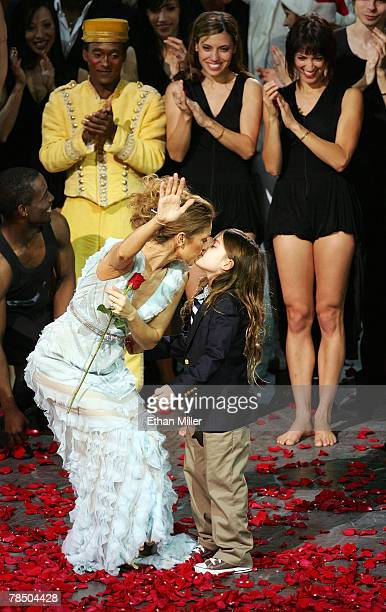 Singer Celine Dion kisses her son ReneCharles Angelil as she waves to the audience after the final performance of her show 'A New Day' at The...