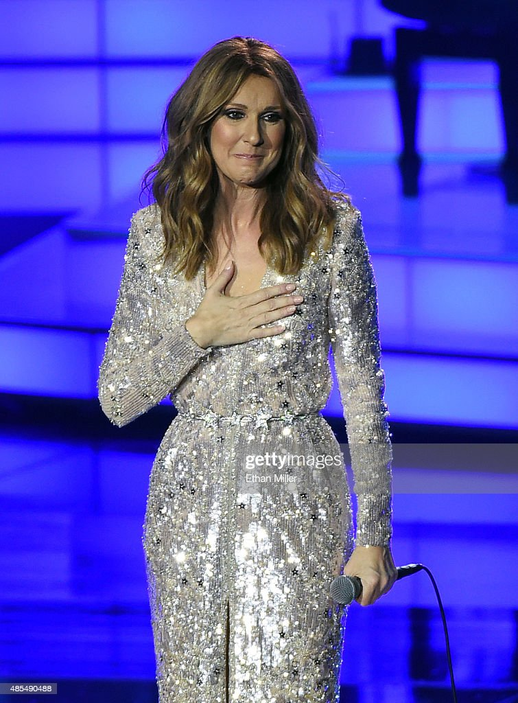 Singer Celine Dion reacts to a standing ovation from the audience as she performs at The Colosseum at Caesars Palace as she resumes her residency on August 27, 2015 in Las Vegas, Nevada. The show had been on hiatus since August 2014 when Dion stopped performing to care for her ailing husband Rene Angelil.