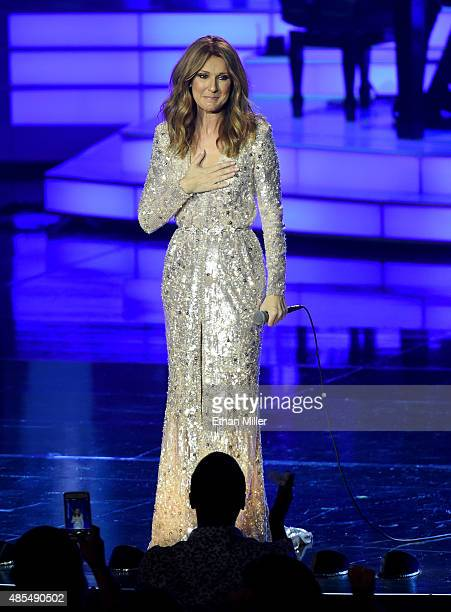 Singer Celine Dion reacts to a standing ovation from the audience as she performs at The Colosseum at Caesars Palace as she resumes her residency on...