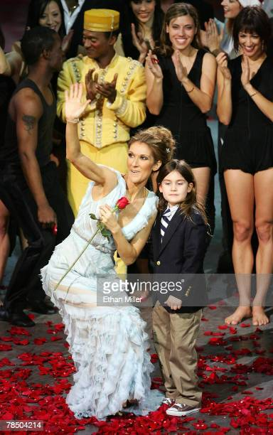 Singer Celine Dion stands with her son ReneCharles Angelil as she waves to the audience after the final performance of her show 'A New Day' at The...