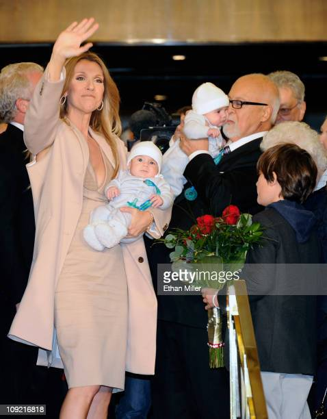 Singer Celine Dion waves as she holds her son Nelson Angelil next to her husband and manager Rene Angelil holding their son Eddy Angelil and their...
