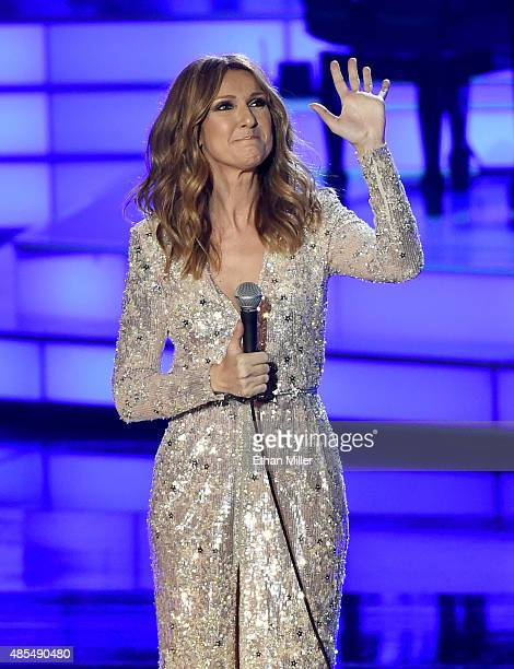 Singer Celine Dion waves as she performs at The Colosseum at Caesars Palace as she resumes her residency on August 27 2015 in Las Vegas Nevada The...