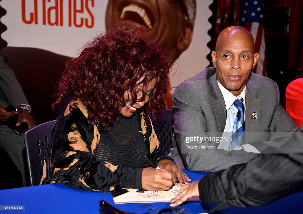 Singer <a gi-track='captionPersonalityLinkClicked' href=/galleries/search?phrase=Chaka+Khan&family=editorial&specificpeople=208691 ng-click='$event.stopPropagation()'>Chaka Khan</a>, Raye Charles Robinson, Jr. Ray Charles' son attend the unveiling of the new Ray Charles stamp at the GRAMMY Museum in Los Angeles, Calif, on Monday, September 23, 2013. The limited-edition stamp is part of the Music Icons stamp series and is available for sale starting today, on what would have been his 83rd birthday, at post offices nationwide