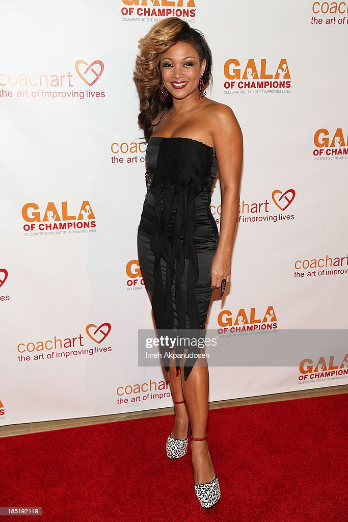 Singer <a gi-track='captionPersonalityLinkClicked' href=/galleries/search?phrase=Chante+Moore&family=editorial&specificpeople=2260137 ng-click='$event.stopPropagation()'>Chante Moore</a> attends CoachArt's 9th Annual 'Gala Of Champions' at The Beverly Hilton Hotel on October 17, 2013 in Beverly Hills, California.