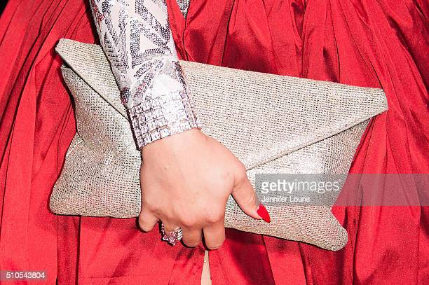 Singer Charisse Mills purse detail arrives at the 2016 City Gala Fundraiser at The Playboy Mansion on February 15 2016 in Los Angeles California