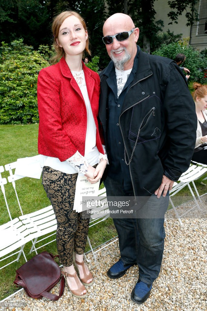 Singer Charlelie Couture (R) and his daughter Yamee attend the Frank Sorbier show as part of Paris Fashion Week Haute-Couture Fall/Winter 2013-2014 at Hotel De Bezenval on July 3, 2013 in Paris, France.
