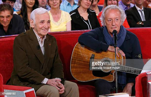 Singer Charles Aznavour and Singersongwriter Didier Barbelivien attend the 'Vivement Dimanche' French TV Show at Pavillon Gabriel on May 27 2015 in...