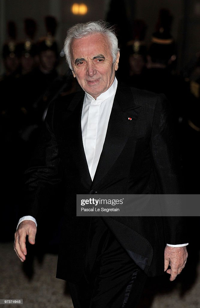 Singer Charles Aznavour arrives to attend a state dinner honouring visiting Russian President Dmitry Medvedev at the Elysee Palace on March 2 2010 in...