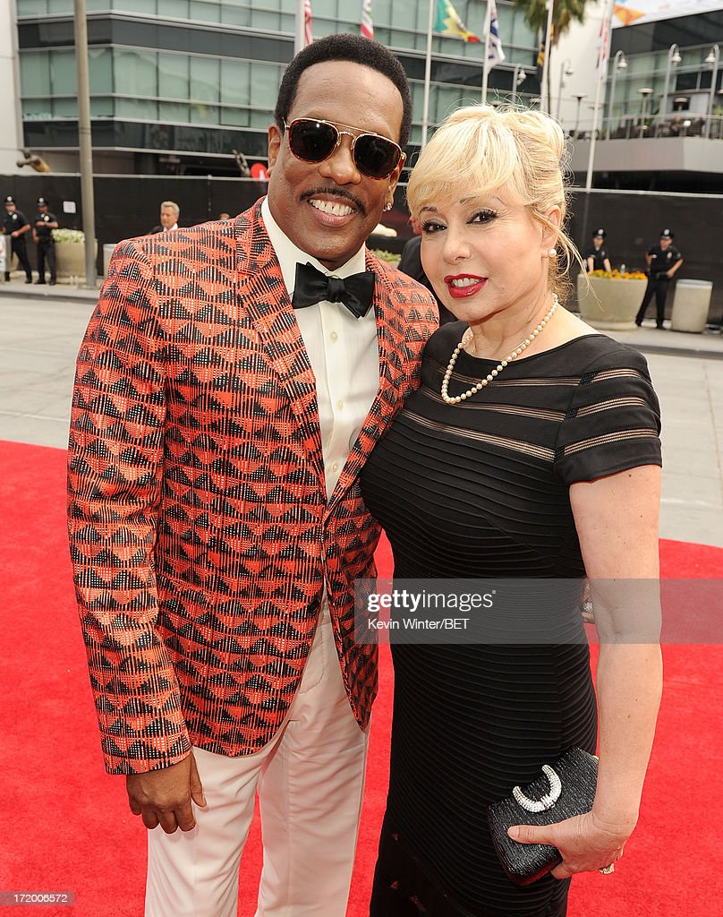 Singer Charlie Wilson and wife Mahin Tat attend the Ford Red Carpet at the 2013 BET Awards at Nokia Theatre L.A. Live on June 30, 2013 in Los Angeles, California.