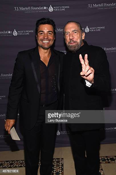 Singer Chayanne and CoFounder Chairman and CEO of John Paul Mitchell Systems and CoFounder of Patron Tequila and Spirits John Paul DeJoria pose...